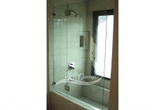 8 Frameless  bathscreen with a radius hinged off an inline panel CLEAR GLASS CHROME HARDWARE 1141 - 1241