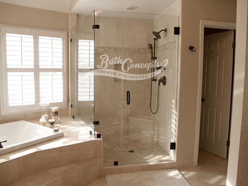 11 Frameless corner enclosure with an inline & return stationary panel CLEAR GLASS OIL RUBBED BRONZE HARDWARE 1193 - 1293
