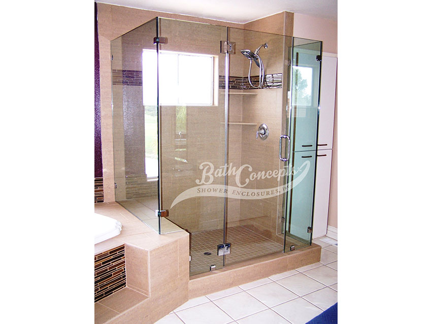 25 Frameless corner enclosure with door hinged off the inline stationary panel & an extra stationary inline panel & 2 return panels CLEAR GLASS CHROME HARDWARE 1193 - 1293