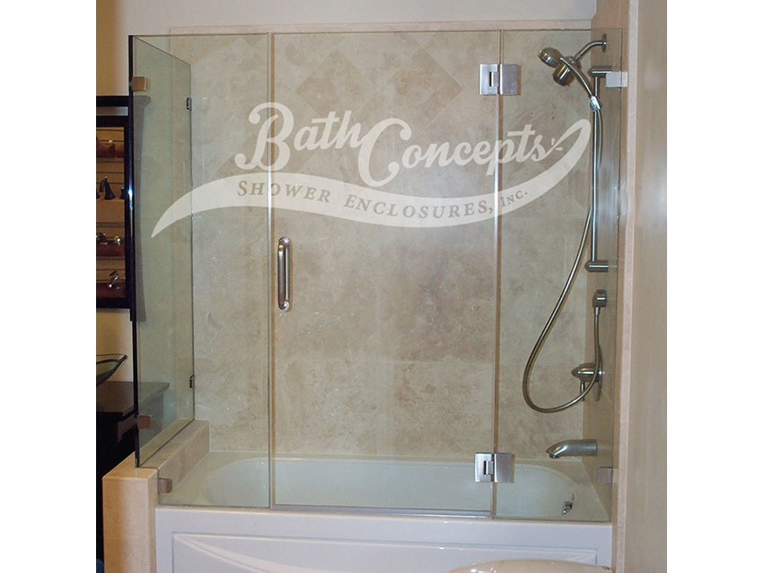5 Frameless corner enclosure with door hinged off the inline stationary panel & an extra stationary inline panel CLEAR GLASS BRUSHED NICKEL HARDWARE 1143 - 1243