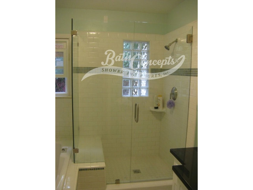 8 Frameless corner enclosure with an inline & return stationary panel CLEAR GLASS BRUSHED NICKEL HARDWARE 1193 - 1293