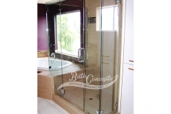 26 Frameless corner enclosure with door hinged off the inline stationary panel & an extra stationary inline panel & 2 return panels CLEAR GLASS CHROME HARDWARE 1193 - 1293