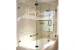7 Frameless corner enclosure with an inline & return stationary panel with a towel bar on the inline panel CLEAR GLASS BRUSHED NICKEL HARDWARE 1143 - 1243