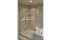 9 Frameless corner enclosure with an inline & return stationary panel CLEAR GLASS BRUSHED NICKEL HARDWARE 1193 - 1293