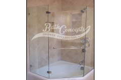 2 1294 Frameless neo angle enclosure on tub with door hinged off the wall and 2 135 degree angled panels & towel bar on panel CLEAR GLASS CHROME HARDWARE 1194 - 1294