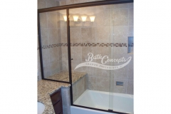 11 Frameless traditional sliding enclosure and an inline panel with 2 knobs CLEAR GLASS OIL RUBBED BROZE HARDWARE 374 -1074